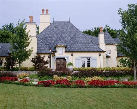 french roof styles roof elements curved arches steep peonies and orange blossoms french style houses part 2