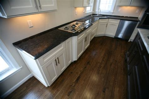 dark brown granite countertops with white cabinets brown kitchen cabinets with black granite quicua
