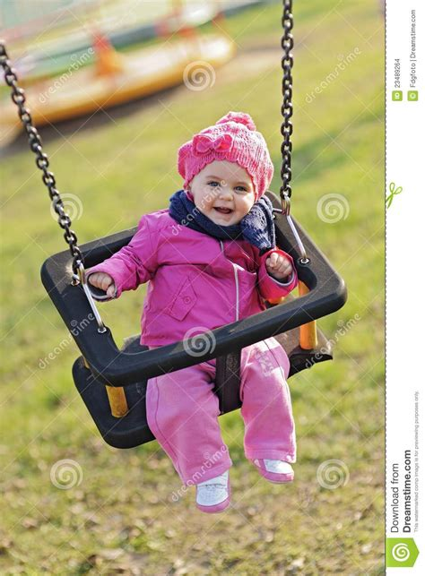 baby play swing happy baby playing with the swing stock images image