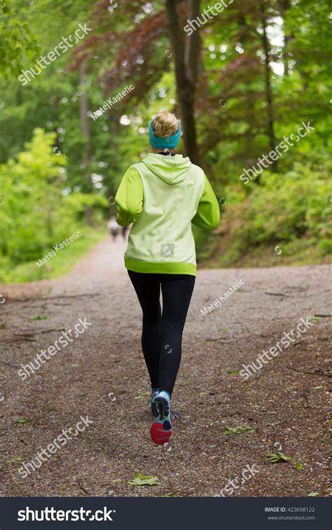Runner For Backyard by Sporty Runner Forest Running Stock Photo