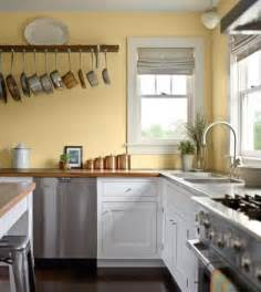 pale yellow wall color with white kitchen cabinet for