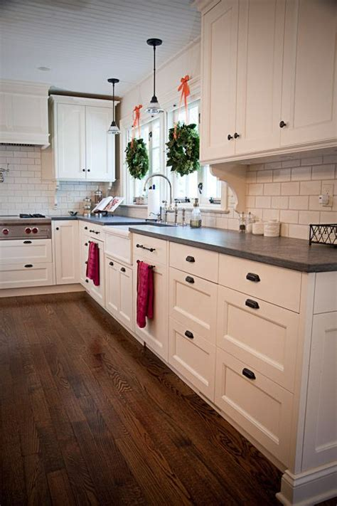 Black Handles For Kitchen Cabinets by White Cabinets Honed Slate Counter Tops And Black Handles