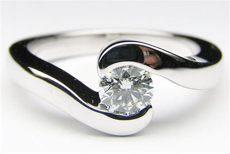 engagement ring modern swirl solitaire