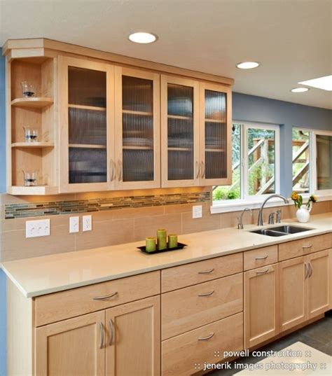 light maple kitchen cabinets natural maple cabinets with caeserstone desert limestone