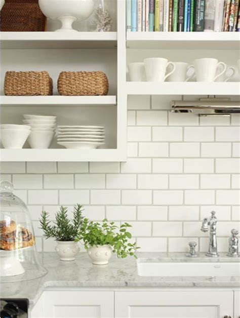 up of small white brick tiles with grey grout 28