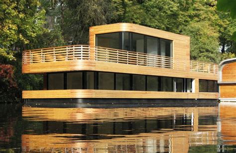 boat house builders wood wrapped floating house maximizes urban growth