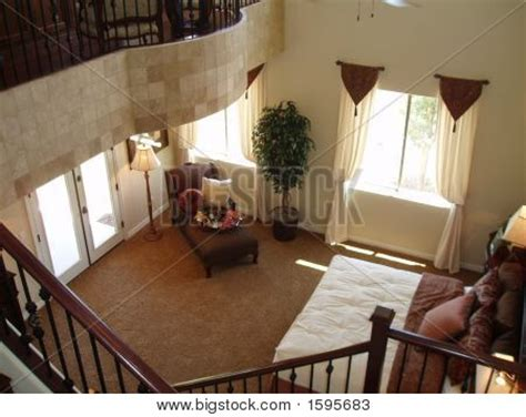 two story master suite picture or photo of two story elegant master bedroom in