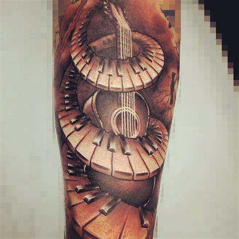 grey ink guitar and piano keys tattoo on arm tattooshunt com