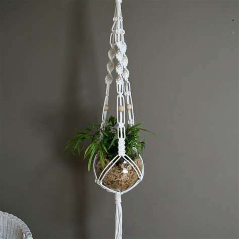 Macrame Flower Knot - cool macrame plant hanger ideas for your sweet home