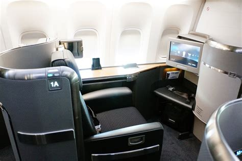 scow a class what it s really like to fly overseas in first class