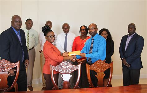social security housing social security signs loan agreement and presents cheque to nevis housing and land