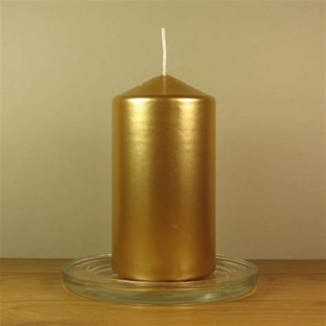 gold and cream pillar candles eika candles 11cm gold pillar candles
