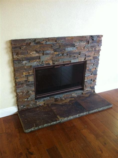 sweet stacked slate fireplace living room