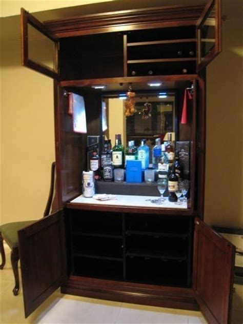 armoire liquor cabinet how to repurpose an outdated tv armoire liquor cabinet