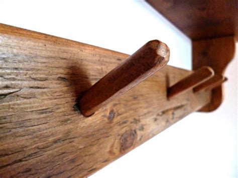 Wooden Coat Pegs With Shelf by Rustic Wooden Shelf With Coat Pegs