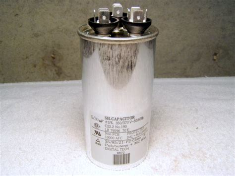 bad capacitor appearance i a goodman ck24 1b ac unit turn on the ac fan and