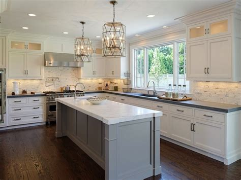 gray and white kitchen cabinets faceted light pendants transitional kitchen blue
