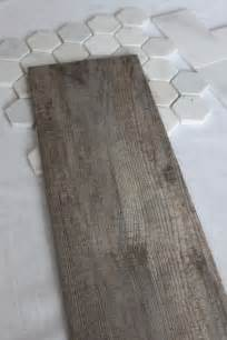 The bathroom floor will wear this tile it looks like a weathered wood