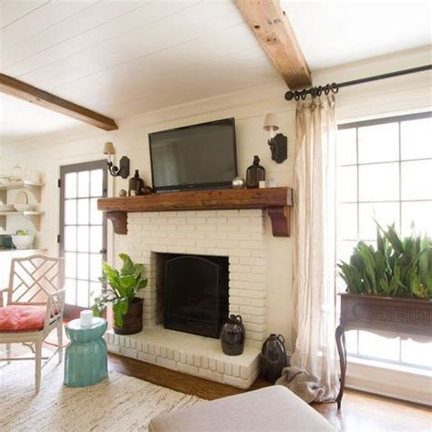 white brick fireplace with wood mantel trgn