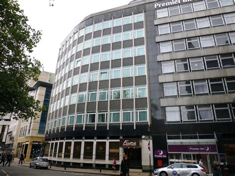 premier inn waterloo exterior view of hotel rooms follow around curve of