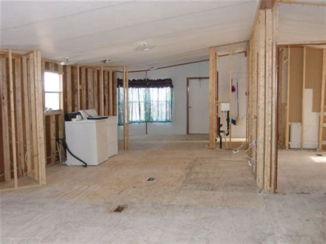 cost to gut a house to the studs removing walls in a mobile home