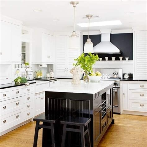 white kitchen with black island black and white kitchen transitional kitchen