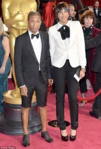 5 things about pharrells wife helen lasichanh you never pharrell williams relaxes on a miami beach with wife helen