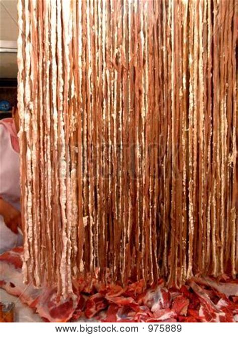 big meat curtains butcher behind a curtain of fresh meat stock photo stock