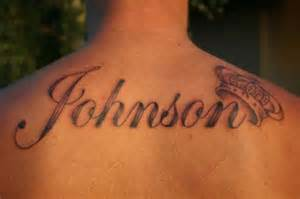 Johnson name with crown tattoo on upper back