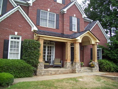 Atlanta Rugs Unpainted Front Porch Addition To Traditional Brick Home