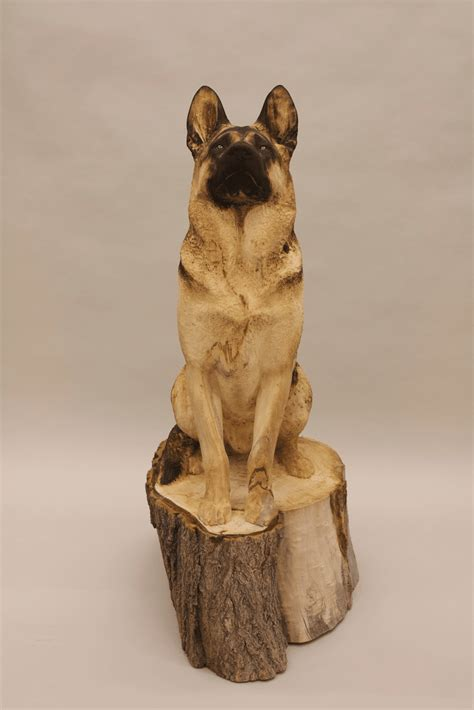 wooden animal sculptures  carved   single tree trunk