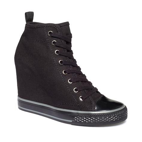 Dkny Kanvas dkny grommet wedge sneakers in black black canvas lyst