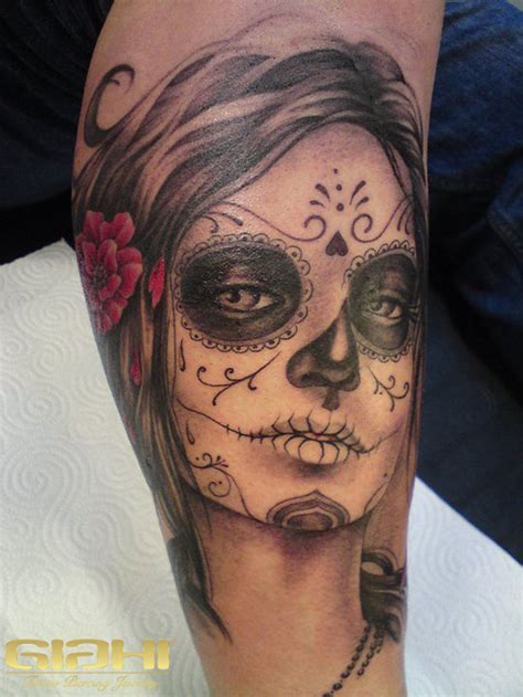 tattooed santa black santa muerte with a in hair