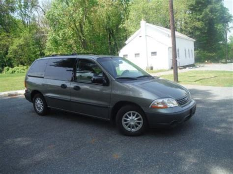 find   ford windstar lx mini passenger van  miles  owner clean carfax nice  bel