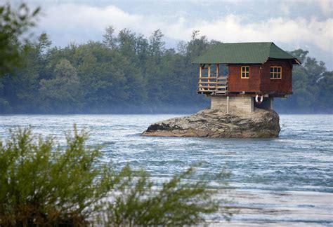 river house house built on a rock in middle of river in serbia cute and weird
