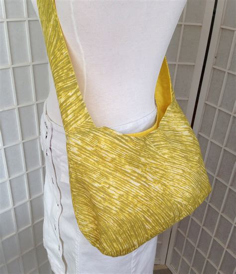 Features Bag Wishlist by Marimekko Hobo Slouch Crossbody Bag Linen Yellow
