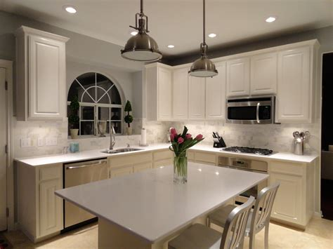 white kitchen cabinets with quartz countertops with oak