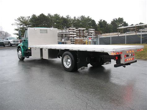 flat bed trucks flat bed trucks fileflatbed truck with hitchhiker forkliftjpg various old articuated