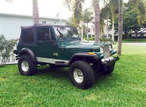 1990 jeep wrangler green with black soft top