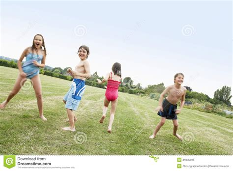 what is the approximate playing time of full version of jana gana mana kids in swimsuits playing on field royalty free stock