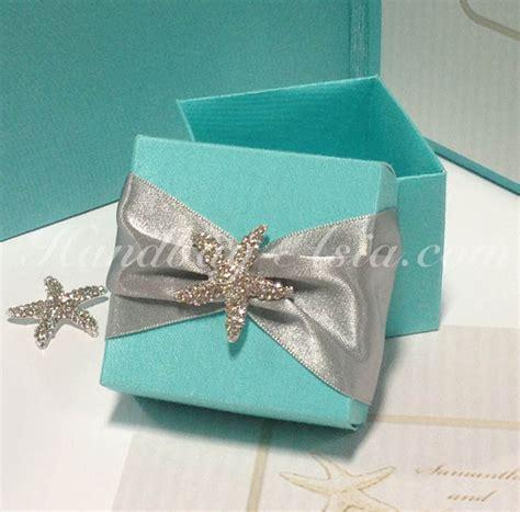 blue silk wedding favour box with starfish rhinestone brooch