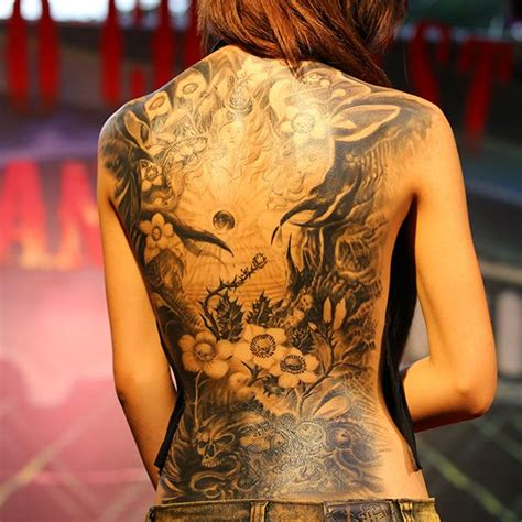back piece tattoos female the shadow work and detail on this back is so