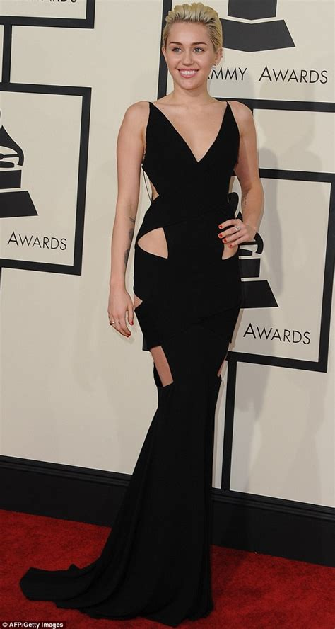 Dress Mily miley cyrus stuns in backless black cut out dress at