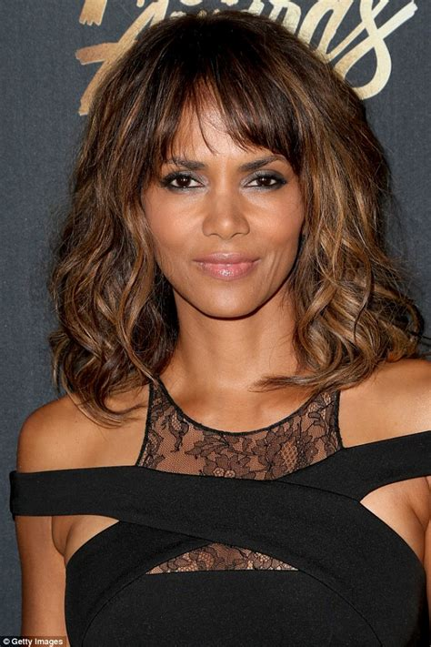 what does halle barre use in her hair to grt it to stand up on top halle berry dramatically reads britney spears 2000 hit