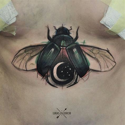 beetle tattoo meaning sternum taaaatt the colors in the bug and the moon