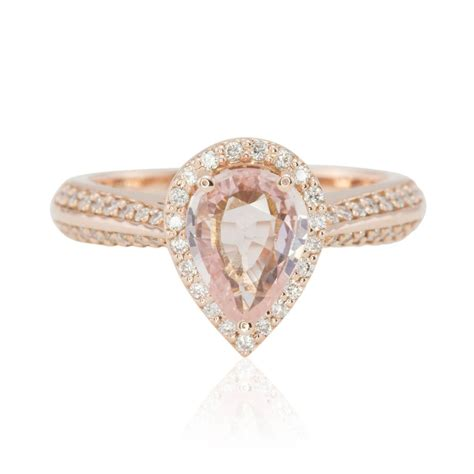 pear cut light pink sapphire engagement ring in gold