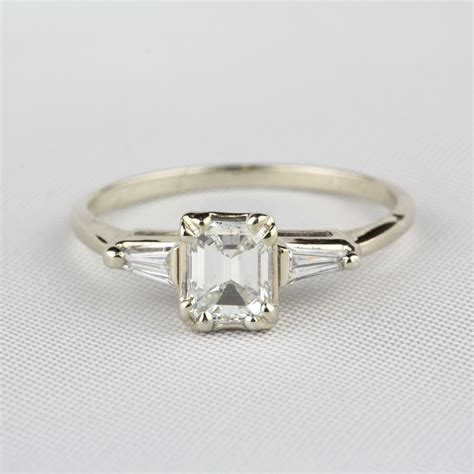 pre owned emerald cut engagement ring