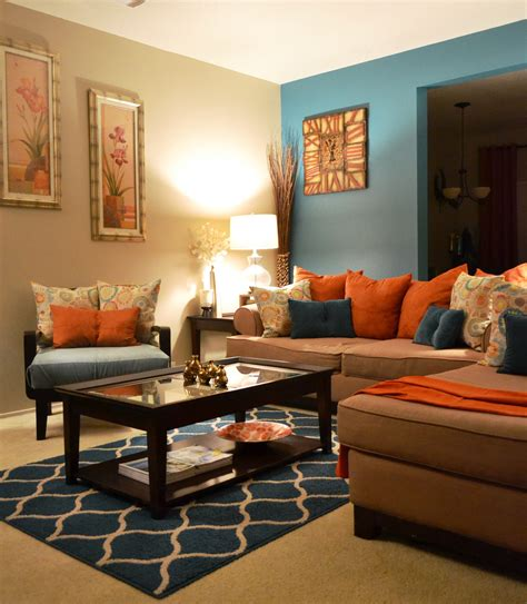 orange walls living room rugs coffee table pillows teal orange living room