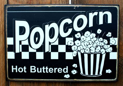 buttered popcorn tin sign home theater room