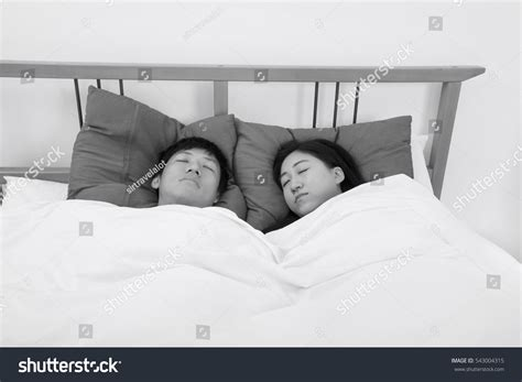 sleeping in asia asian couple sleeping in bed stock photo 543004315